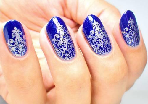unha decorada azul royal fotos