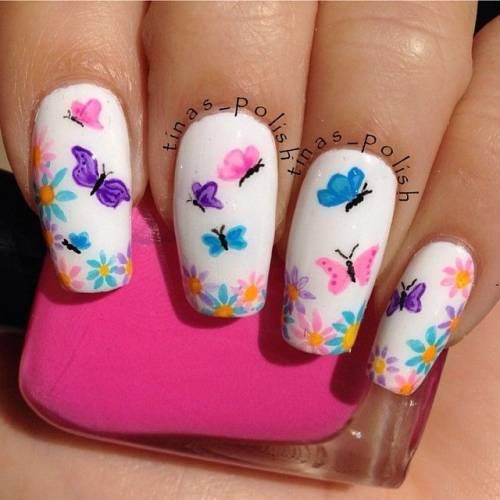 ideia de nail art de flor e borboleta